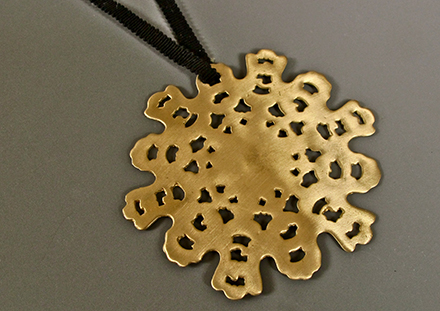 Biscuit pendant in brass