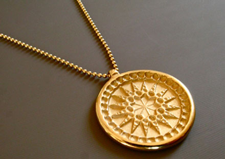 Médaille soleil, or 18ct