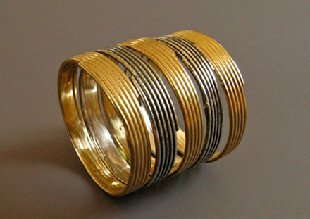 Stacking rings, oxidized platinium silver and 14k or 18k gold